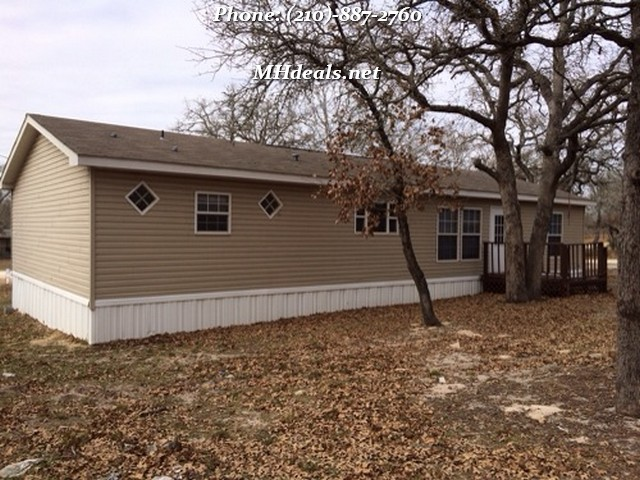 how to buy a manufactured home and land