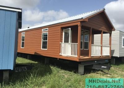 2 bedroom 1 bath cedar sided porch cabin exterior