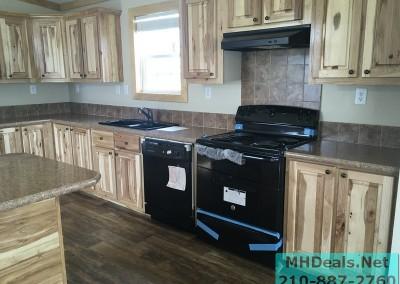2 bedroom 1 bath cedar sided porch cabin kitchen