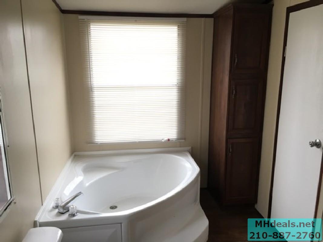 4 bedroom 2 bath double wide on 1 acre in San Antonio